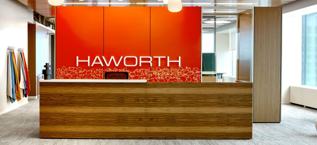 A reception desk made of book-matched sappy Red Gum wood veneer.